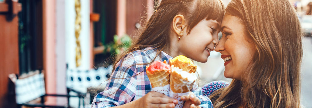 mom with her daughter face to face with ice cream