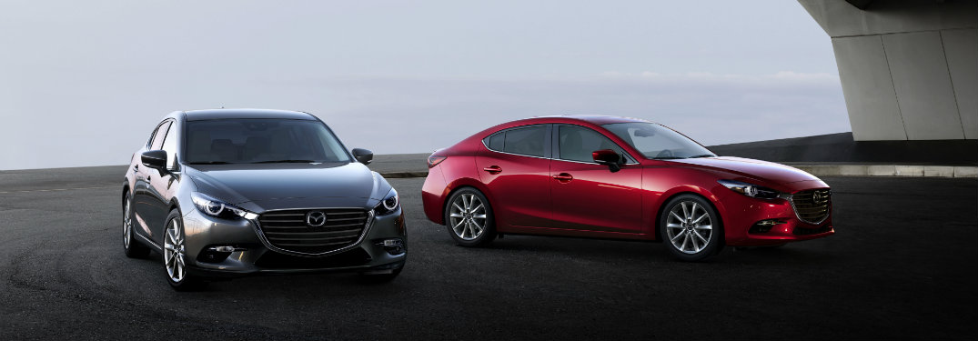 red and gray mazda3 cars on diplay