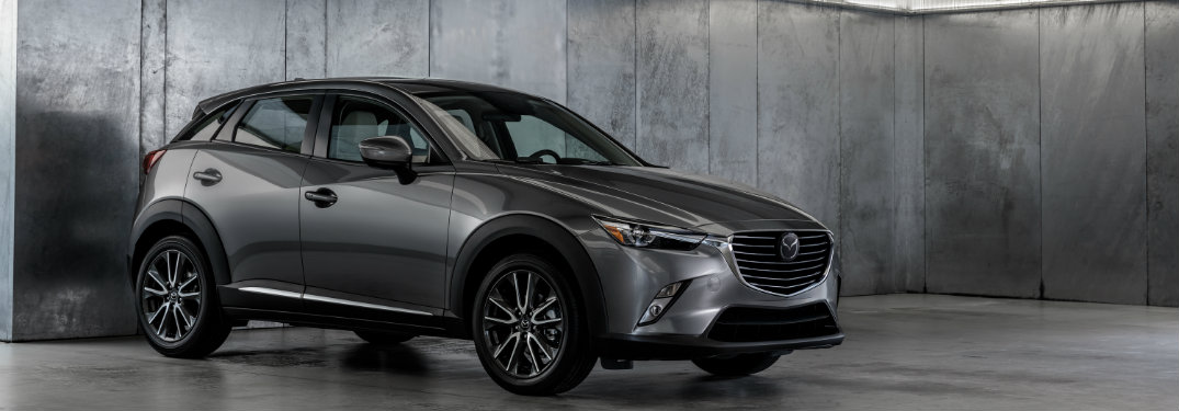 silver mazda cx-3 in cement room