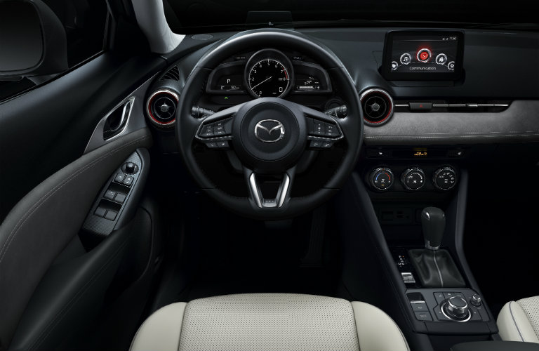steering wheel and front interior of  mazda cx-3
