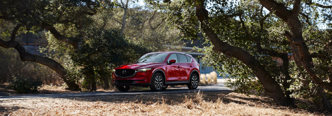 red mazda cx-5 by trees