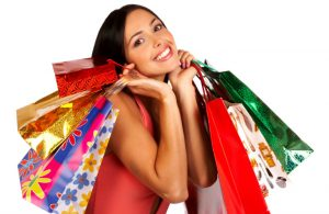 woman smiling and holding shopping bags