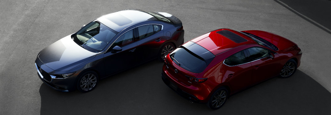 aerial view of gray and red mazda3 cars