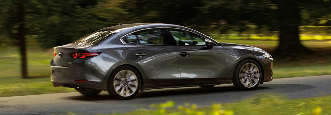 Passenger side exterior view of a gray 2019 Mazda3
