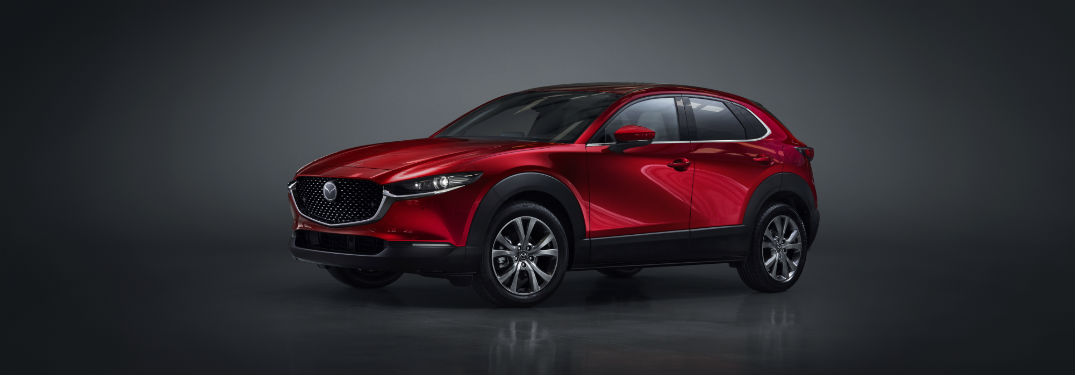 Driver side exterior view of a red 2020 Mazda CX-30