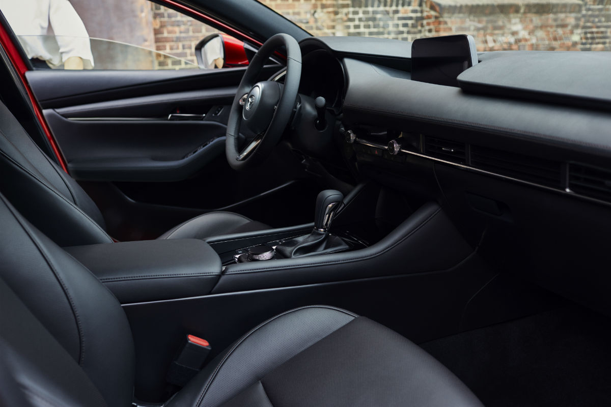 Side view of the driver's cockpit of the 2019 Mazda3