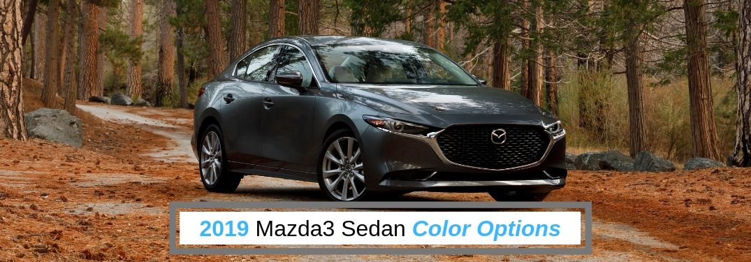 2019 Mazda3 Sedan Color Options, text beneath a front passenger side exterior image of a gray 2019 Mazda3 Sedan