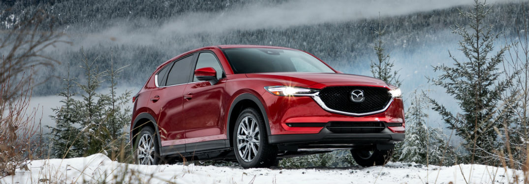 Front passenger side exterior view of a red 2019 Mazda CX-5