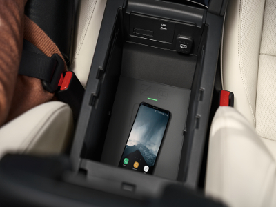 A phone charging using the 2019 Mazda3 wireless phone charger accessory