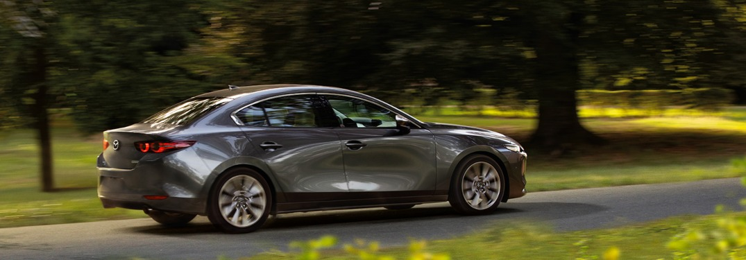 2019 Mazda3 driving down a country road