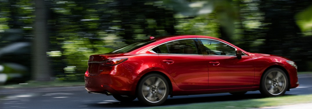 2019 Mazda6 driving down a forest road