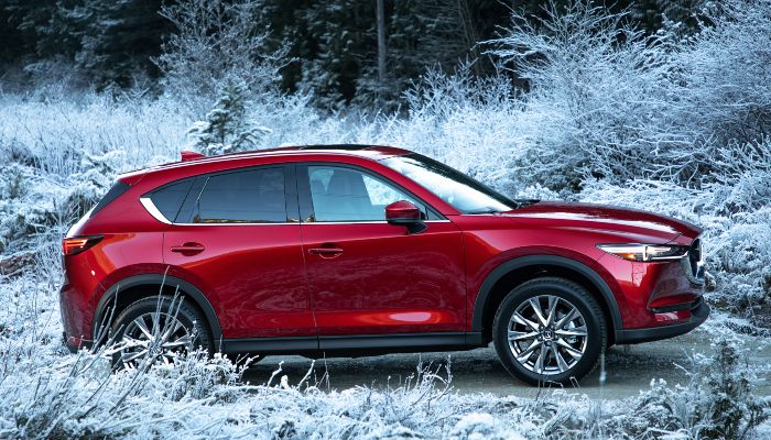 2019 Mazda CX-5 driving up an incline in winter