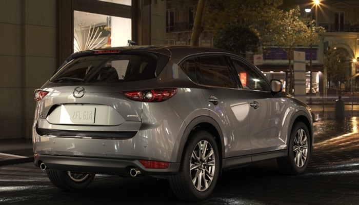 2019 Mazda CX-5 driving down an urban street