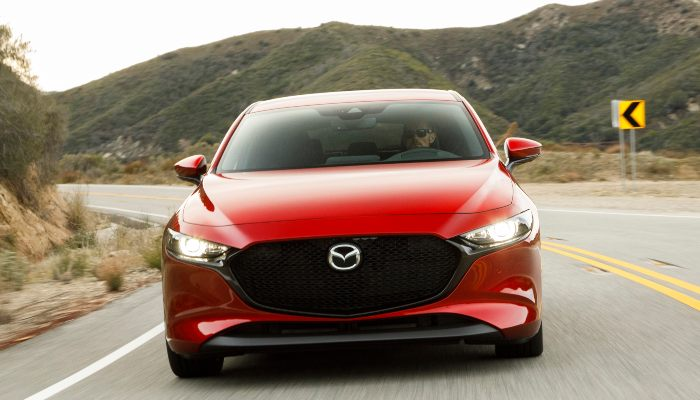 2019 Mazda3 driving down a curved road