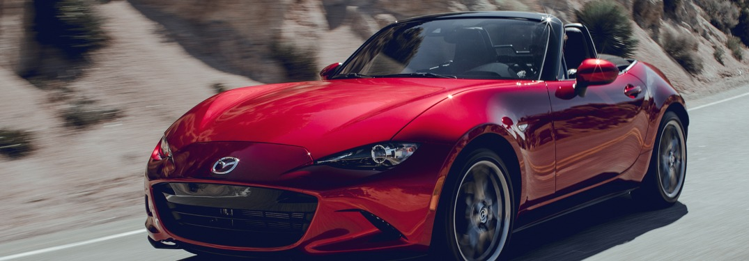 2019 Mazda MX-5 Miata driving down a desert road