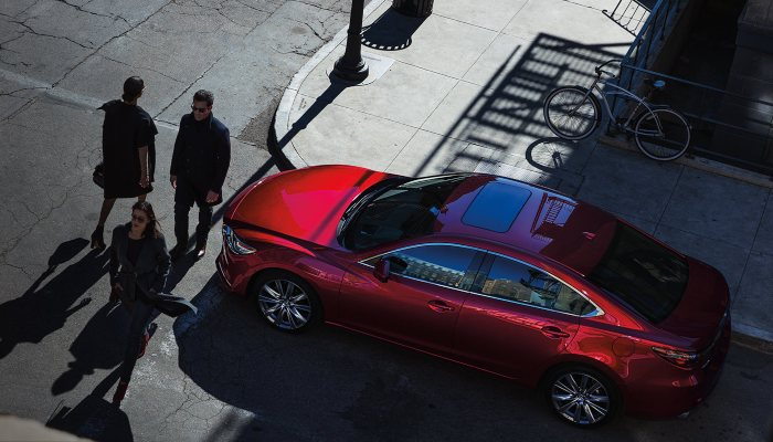 A 2019 Mazda6 stopped for crossing pedestrians