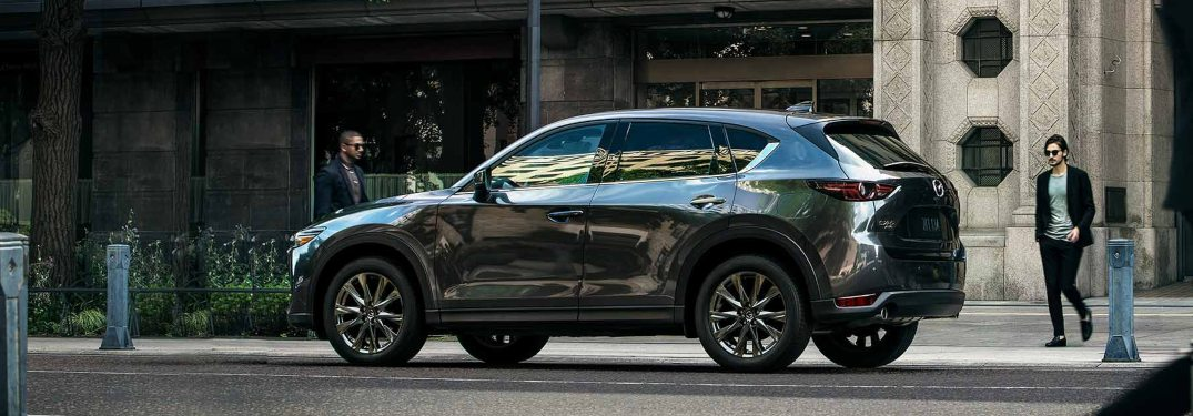 What features come standard in the 2019 Mazda CX-5 Sport?