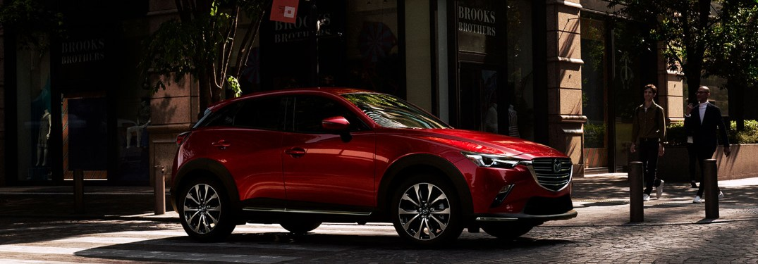 2019 Mazda CX-3 stopped for a crossing pedestrian