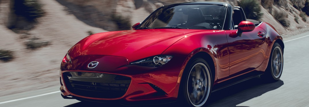 2019 Mazda MX-5 Miata driving down a rural road