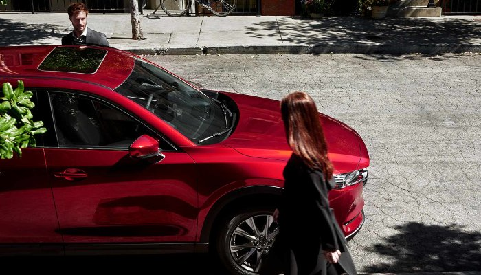 Two people entering a 2019 Mazda CX-5