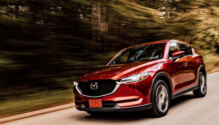 2019 Mazda CX-5 driving down a rural road