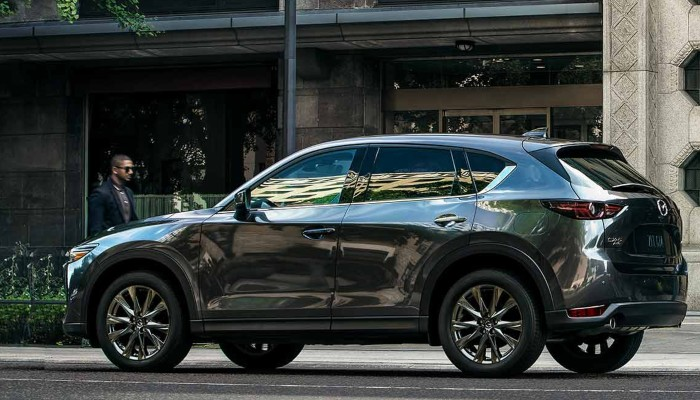 2019 Mazda CX-5 parked in front of a building