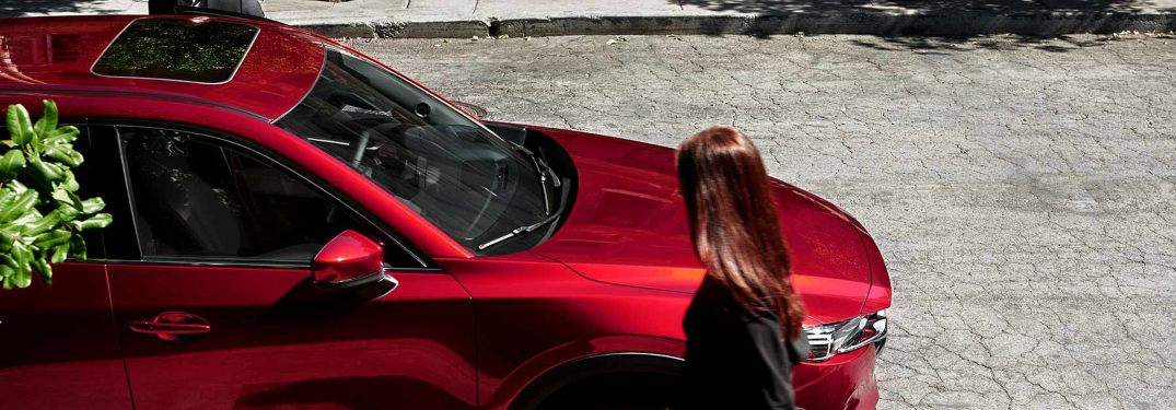 A woman entering a 2019 Mazda CX-5