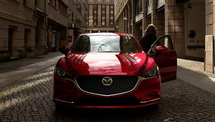 A person exiting a 2020 Mazda6