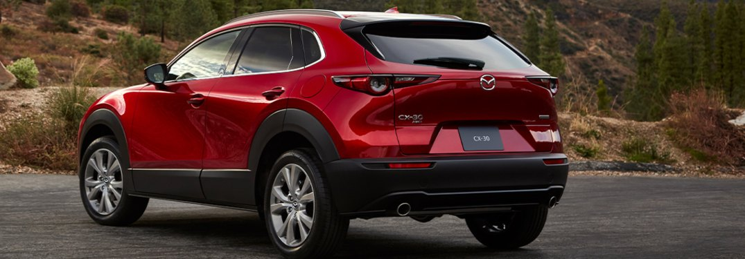 2020 Mazda CX-30 driving down a rural road