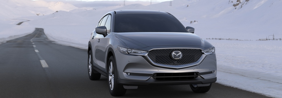 2020 Mazda CX-5 driving down a road in winter
