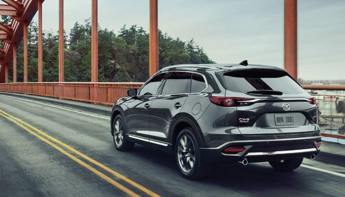 2020 Mazda CX-9 Grand Touring driving over a bridge
