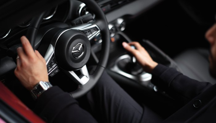 Man driving a 2019 Mazda MX-5 Miata