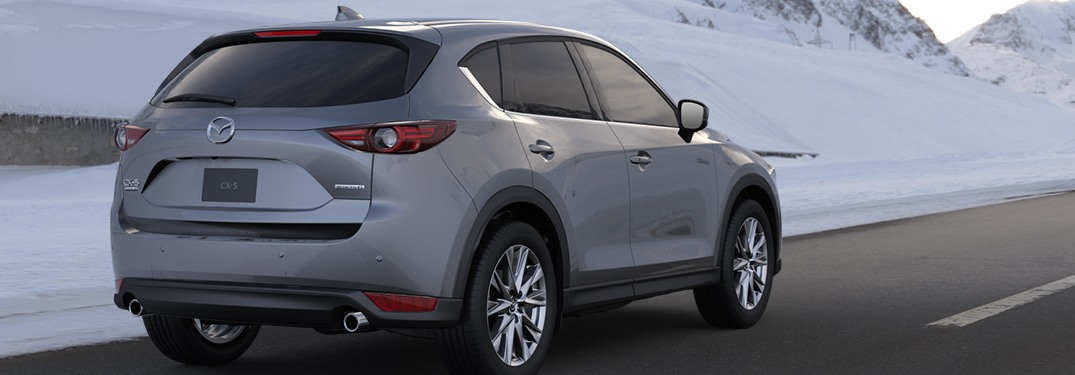 2020 Mazda CX-5 driving down a rural highway road