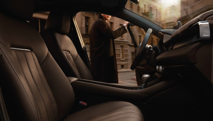 A man entering a 2020 Mazda6