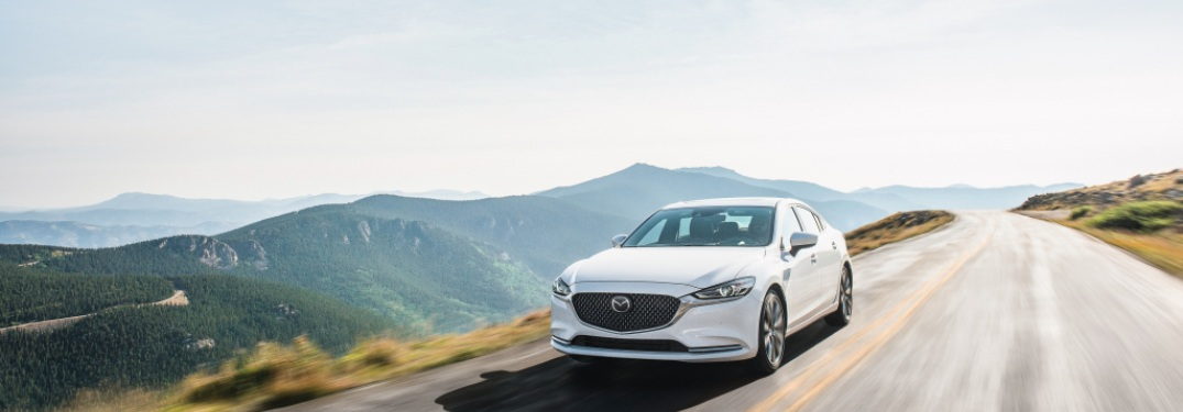 2020 Mazda6 driving down a highway road