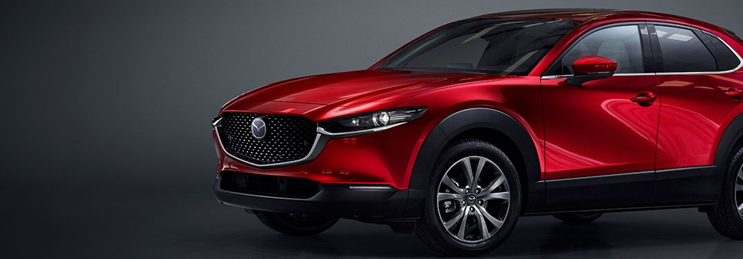 2020 Mazda CX-30 parked over an abstract background