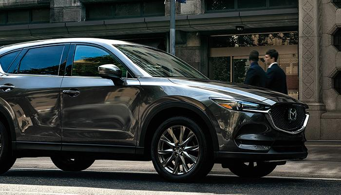 2020 Mazda CX-5 parked in front of a building