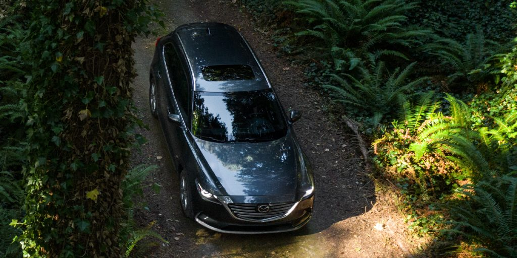 2020 Mazda CX-9 driving down a forest road