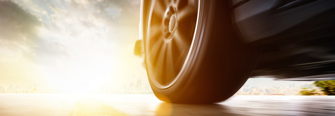 Low angle view of a car's tire on a sunny day