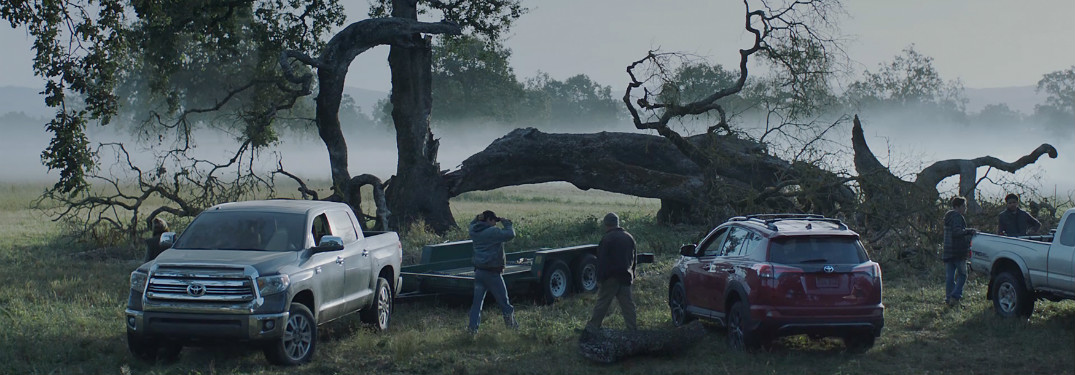 "snapshot from toyota's ""r+s"" commercial featuring multiple toyota trucks helping cut down tree"