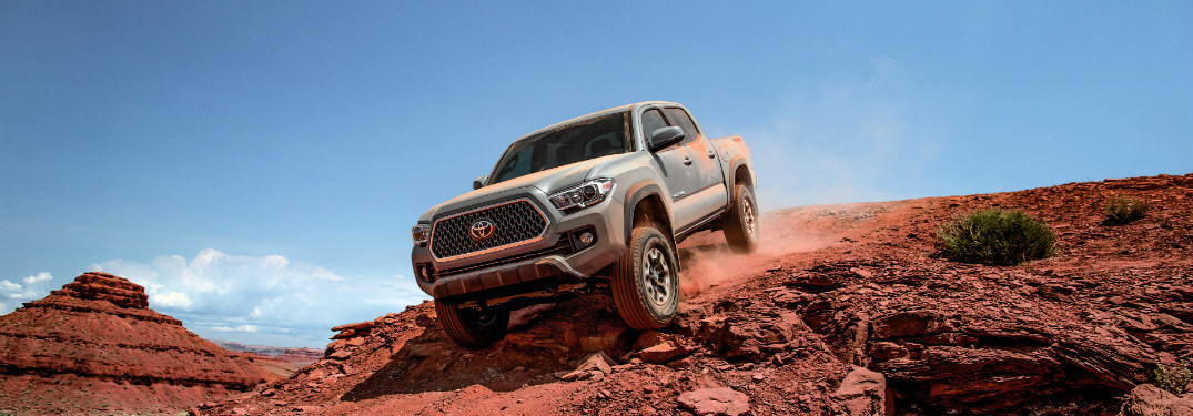 gray 2018 toyota tacoma descending desert hill