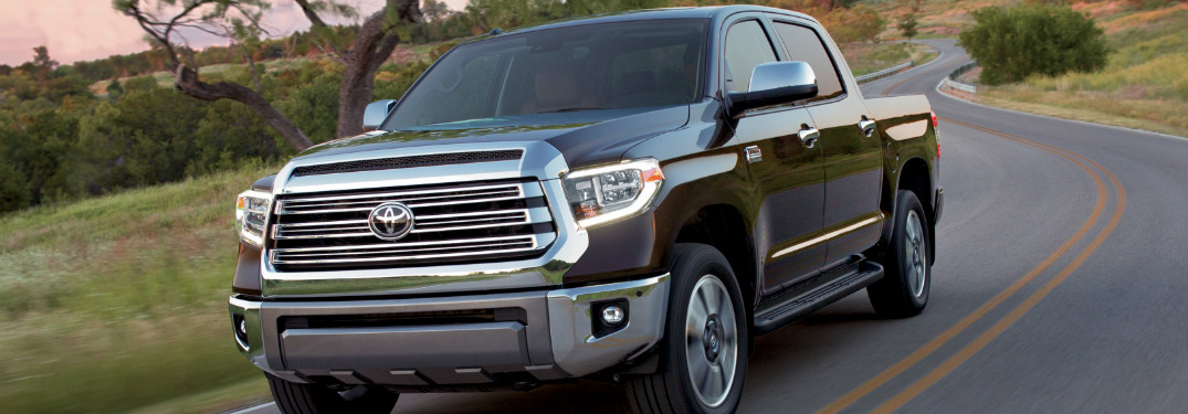 black 2018 toyota tundra driving on country road