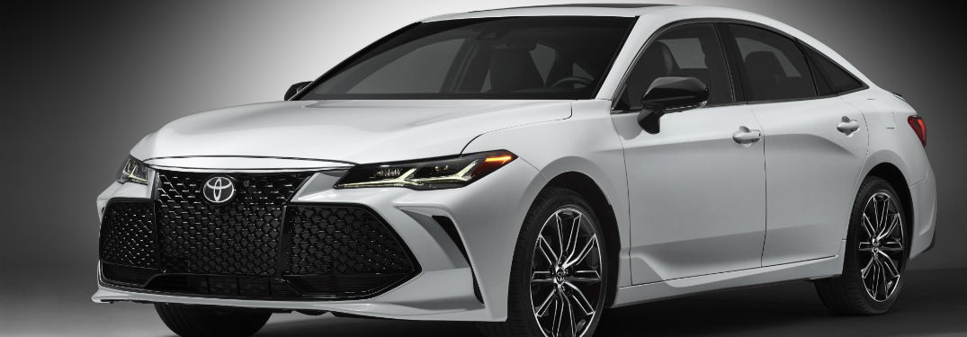 white 2019 toyota avalon against black background
