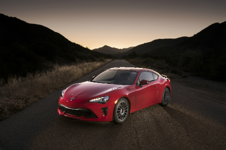 red 2018 toyota 86 on highway at sunset