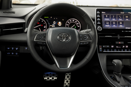 front interior of 2019 toyota avalon including steering wheel and infotainment system