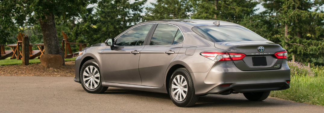 rear and side view of silver 2019 toyota camry hybrid