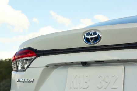 rear spoiler and taillight of white 2020 toyota corollla hybrid