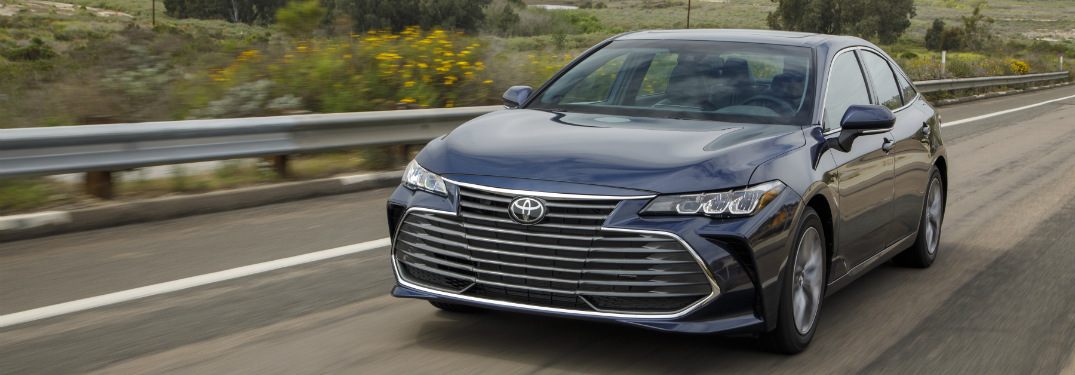 front and side view of blue 2019 toyota avalon