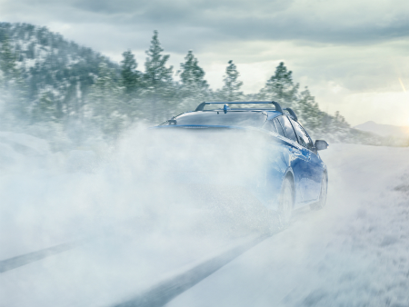 rear view of blue 2019 toyota prius awd-e driving in snow