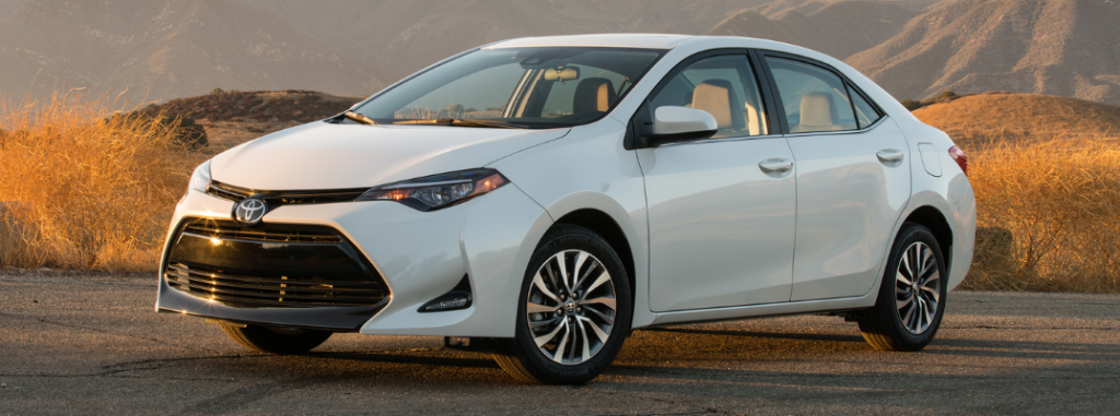 front and side view of white 2019 toyota corolla